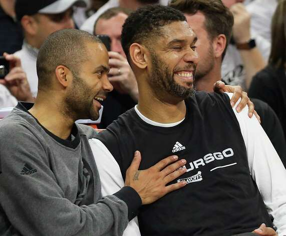 Tony Parker and Tim Duncan share a laugh on the bench in the fourth quarter as the Spurs host the Thunder in game 1 of second round NBA playoff action at the AT&T Center on April 230, 2016. Photo: TOM REEL, STAFF / SAN ANTONIO EXPRESS-NEWS / 2016 SAN ANTONIO EXPRESS-NEWS