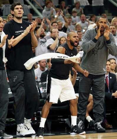 Patty Mills leads the cheers from the bench as Danny Green hits another three pointer as the Spurs host the Thunder in game 1 of second round NBA playoff action at the AT&T Center on April 230, 2016. Photo: TOM REEL, STAFF / SAN ANTONIO EXPRESS-NEWS / 2016 SAN ANTONIO EXPRESS-NEWS