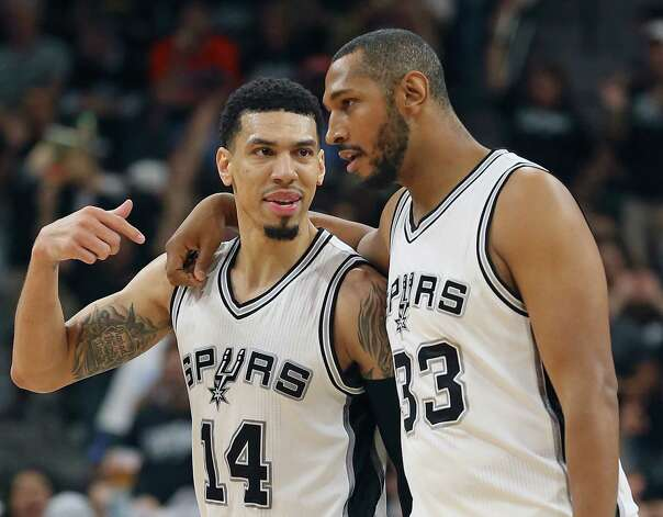 Danny Green and Boris Diaw chum up after Green hit yet another three pointer in the second half as the Spurs host the Thunder in game 1 of second round NBA playoff action at the AT&T Center on April 230, 2016. Photo: TOM REEL, STAFF / SAN ANTONIO EXPRESS-NEWS / 2016 SAN ANTONIO EXPRESS-NEWS