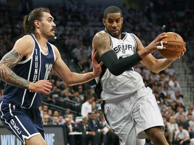 LaMarcus Aldridge moves to the lane on the left side against Steven Adams as the Spurs host the Thunder in game 1 of second round NBA playoff action at the AT&T Center on April 230, 2016. Photo: TOM REEL, STAFF / SAN ANTONIO EXPRESS-NEWS / 2016 SAN ANTONIO EXPRESS-NEWS
