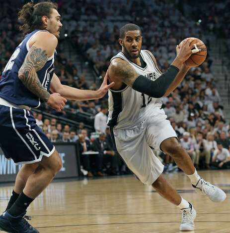 LaMarcus Aldridge rolls into the lane against Steven Adams as the Spurs host the Thunder in game 1 of second round NBA playoff action at the AT&T Center on April 230, 2016. Photo: TOM REEL, STAFF / SAN ANTONIO EXPRESS-NEWS / 2016 SAN ANTONIO EXPRESS-NEWS