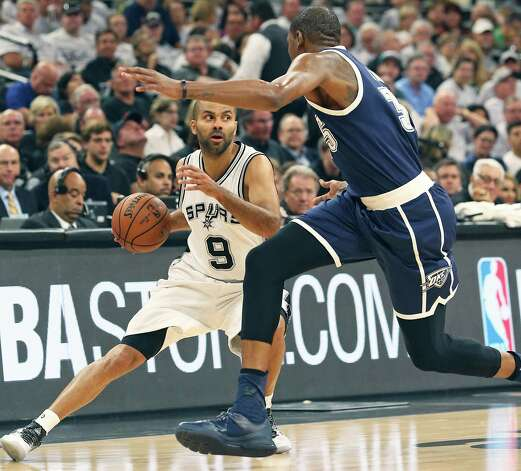 Tony Parker has Kevin Durant racing down the court as the Spurs host the Thunder in game 1 of second round NBA playoff action at the AT&T Center on April 230, 2016. Photo: TOM REEL, STAFF / SAN ANTONIO EXPRESS-NEWS / 2016 SAN ANTONIO EXPRESS-NEWS