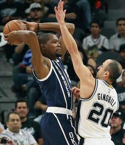 Kevin Durant is pressured by Manu Ginobili as the Spurs host the Thunder in game 1 of second round NBA playoff action at the AT&T Center on April 230, 2016. Photo: TOM REEL, STAFF / SAN ANTONIO EXPRESS-NEWS / 2016 SAN ANTONIO EXPRESS-NEWS
