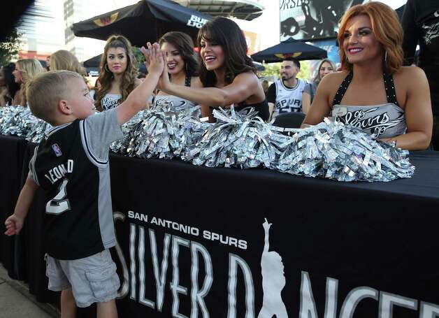 Three year old Buster Haley high fives the Silver Dancers before game time as the Spurs host the Thunder in game 1 of second round NBA playoff action at the AT&T Center on April 230, 2016. Photo: TOM REEL, STAFF / SAN ANTONIO EXPRESS-NEWS / 2016 SAN ANTONIO EXPRESS-NEWS