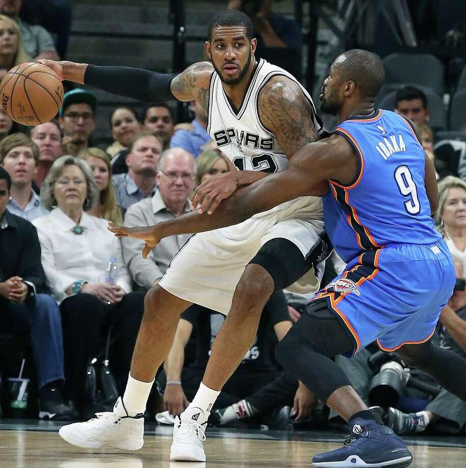 LaMarcus Aldridge pivots on Serge Ibaka as the Spurs host the Thunder in game 2 of second round NBA playoff action at the AT&T Center on May 2, 2016. Photo: TOM REEL, STAFF / SAN ANTONIO EXPRESS-NEWS / 2016 SAN ANTONIO EXPRESS-NEWS