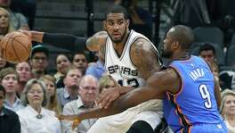 LaMarcus Aldridge pivots on Serge Ibaka as the Spurs host the Thunder in game 2 of second round NBA playoff action at the AT&T Center on May 2, 2016.