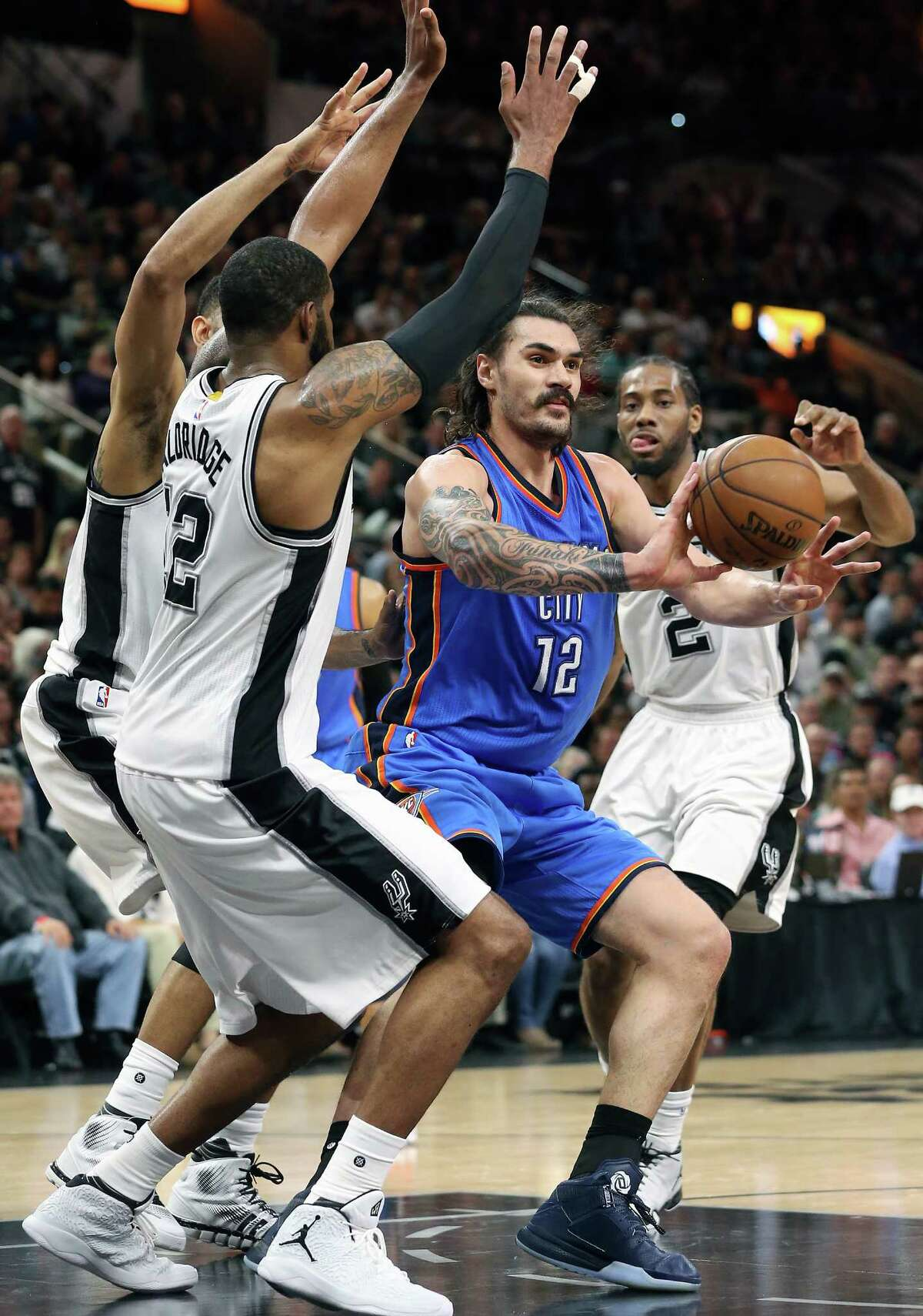 Steven Adams passes to the outside as the Spurs host the Thunder in game 2 of second round NBA playoff action at the AT&T Center on May 2, 2016.