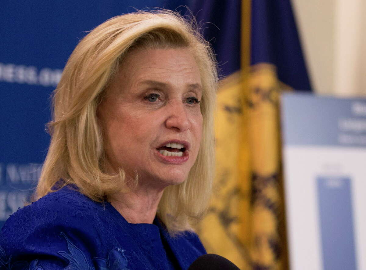 FILE - In this April 12, 2016 file photo, Rep. Carolyn Maloney, D-N.Y. speaks at the National Press Club in Washington. U.S. officials are developing a new, pink commemorative coin to promote breast cancer awareness and raise money for cancer research, said Maloney, who sponsored legislation for its creation. The New York Democrat tells The Associated Press that federal officials will hold a contest to pick artwork that will be displayed on the coin, which is expected to be released in 2018. (AP Photo/Manuel Balce Ceneta, File) ORG XMIT: WX104