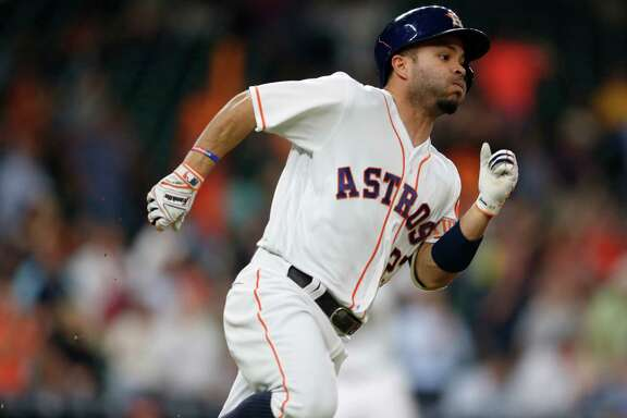 Houston Astros second baseman Jose Altuve (27) runs to second base after hitting an RBI double during the third inning of an MLB baseball game at Minute Maid Park, Monday, May 9, 2016, in Houston.