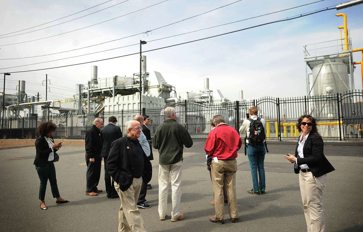 Visitors look at Dominion Energy's Dominion Bridgeport Fuel Cell plant at the Eco-Tech nology Park in Bridgeport.