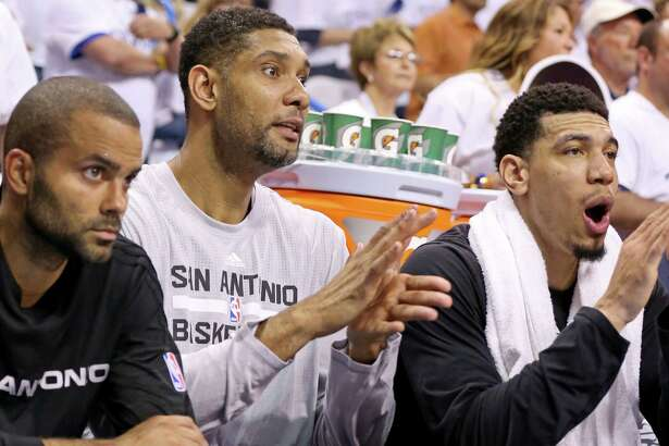 Spurs' Tony Parker, Tim Duncan, and Danny Green watch second half action of Game 4 in the Western Conference semifinals against the Thunder from the bench on May 8, 2016 at Chesapeake Energy Arena in Oklahoma City.