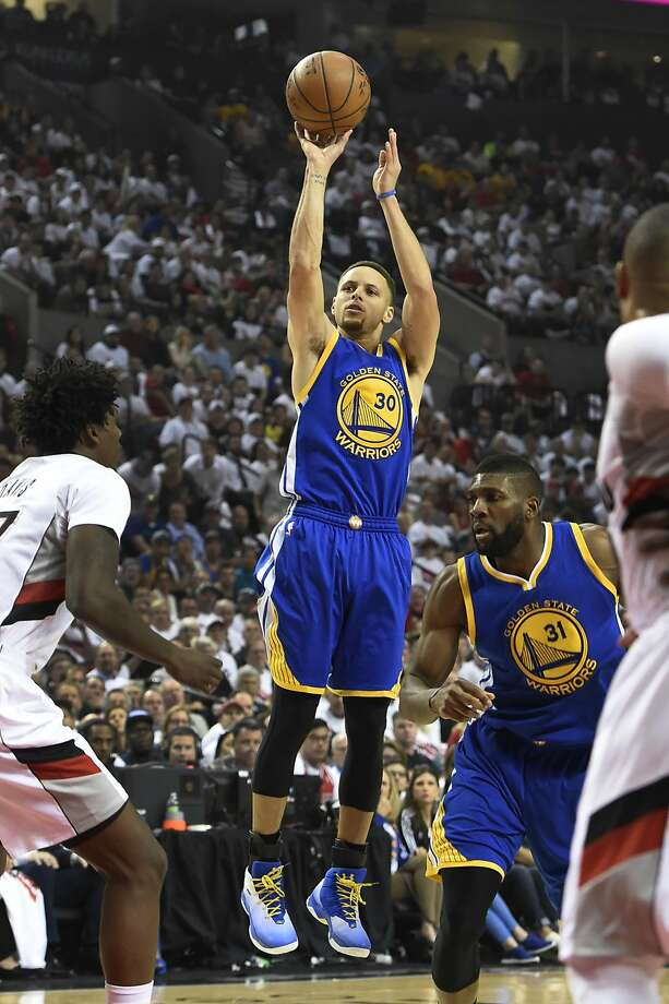 Stephen Curry #30 of the Golden State Warriors shoots the ball on Ed Davis #17 of the Portland Trail Blazers during the first quarter of Game Four of the Western Conference Semifinals during the 2016 NBA Playoffs at the Moda Center on May 9, 2016 in Portland, Oregon. NOTE TO USER: User expressly acknowledges and agrees that by downloading and/or using this photograph, user is consenting to the terms and conditions of the Getty Images License Agreement.  (Photo by Steve Dykes/Getty Images) Photo: Steve Dykes, Getty Images