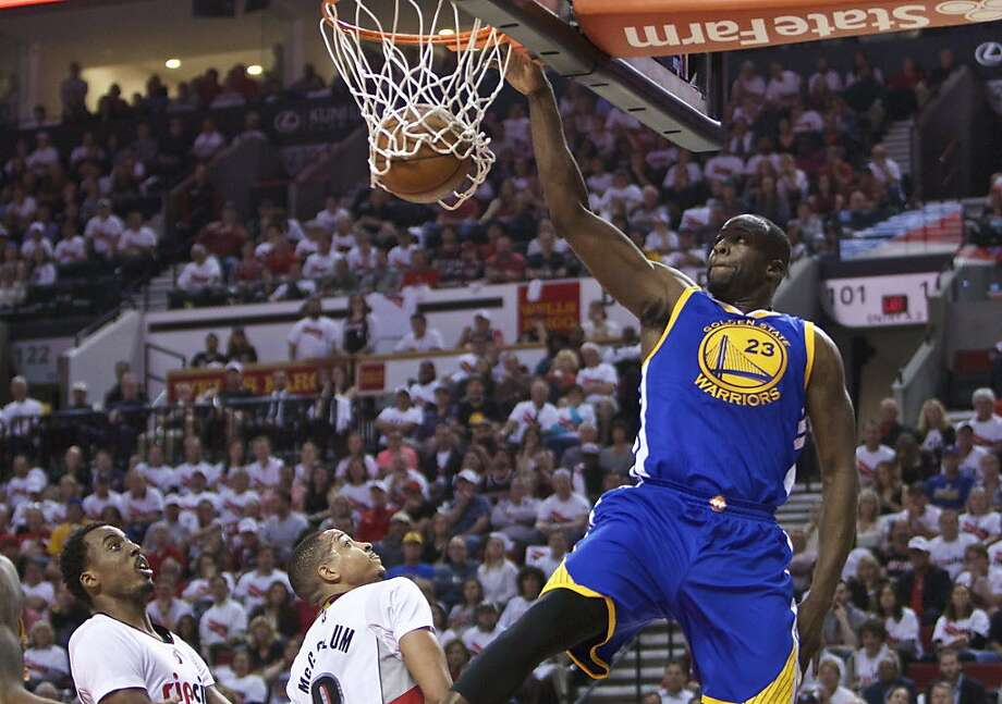 Golden State Warriors forward Draymond Green, right, dunks over Portland Trail Blazers forward Al-Farouq Aminu, left, and C.J. McCollum, center, during the first half of Game 4 of an NBA basketball second-round playoff series Monday, May 9, 2016, in Portland, Ore. (AP Photo/Craig Mitchelldyer) Photo: Craig Mitchelldyer, Associated Press