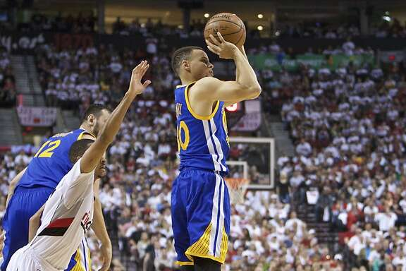 Golden State Warriors guard Stephen Curry, right, shoots over Portland Trail Blazers guard C.J. McCollum, left, during the first half of Game 4 of an NBA basketball second-round playoff series Monday, May 9, 2016, in Portland, Ore. (AP Photo/Craig Mitchelldyer)