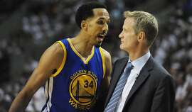 PORTLAND, OR - MAY 9: Shaun Livingston #34 of the Golden State Warriors has some words with head coach Steve Kerr of the Golden State Warriors  during the first quarter of Game Four of the Western Conference Semifinals against the Portland Trail Blazers during the 2016 NBA Playoffs at the Moda Center on May 9, 2016 in Portland, Oregon. NOTE TO USER: User expressly acknowledges and agrees that by downloading and/or using this photograph, user is consenting to the terms and conditions of the Getty Images License Agreement.  (Photo by Steve Dykes/Getty Images)