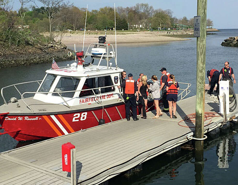 Three college students who lost control of their rowboat in rough seas Monday afternoon were rescued and brought back to shore uninjured by personnel in the Fire Department's Marine 288 boat. Photo: Fairfield Fire Department / Fairfield Fire Department / Fairfield Citizen