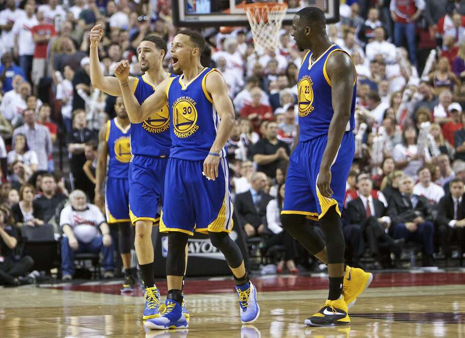 Golden State Warriors guard Stephen Curry, center, guard Klay Thompson, left, and forward Draymond Green, right, react during the second half of Game 4 of an NBA basketball second-round playoff series against the Portland Trail Blazers Monday, May 9, 2016, in Portland, Ore. The Warriors won 132-125. (AP Photo/Craig Mitchelldyer) Photo: Craig Mitchelldyer, Associated Press
