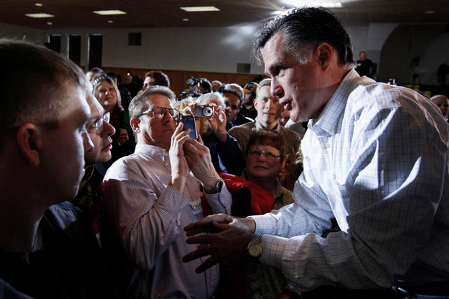 Republican presidential candidate, former Massachusetts Gov. Mitt Romney campaigns at the Mississippi Valley Fairgrounds in Davenport, Iowa, Monday, Jan. 2, 2012. (AP Photo/Charles Dharapak) Photo: Charles Dharapak / AP