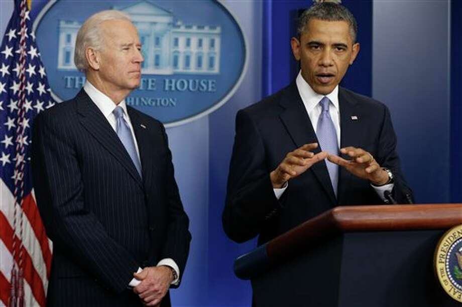 President Barack Obama and Vice President Joe Biden make a statement regarding the passage of the fiscal cliff bill in the Brady Press Briefing Room at the White House in Washington, Tuesday, Jan. 1, 2013. (AP Photo/Charles Dharapak) Photo: Charles Dharapak / AP2013