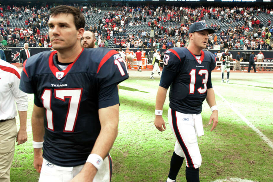 Houston Texans quarterbacks Jake Delhomme (17) and T.J. Yates (13) leave the field after a 23-22 loss to the Tennessee Titans in an NFL football game on Sunday, Jan. 1, 2012, in Houston. The Titans defeated the Texans 23-22. (AP Photo/Dave Einsel) Photo: Dave Einsel / FR43584 AP