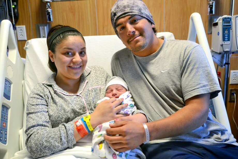 Raigan and Isaac Blanco hold their newborn baby Gavin Ray Blanco Wednesday at Midland Memorial Hospital. Baby Gavin, who was born at 1:22 a.m. Wednesday, is the first baby to be born in Midland in 2013. James Durbin/Reporter-Telegram Photo: JAMES DURBIN