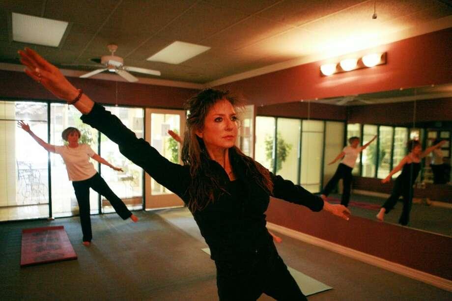 Yoga instructor Dana White teaches a class Dec. 22, at Pilates Reformer and Namaste Yoga Studio. Cindeka Nealy/Reporter-Telegram Photo: Cindeka Nealy