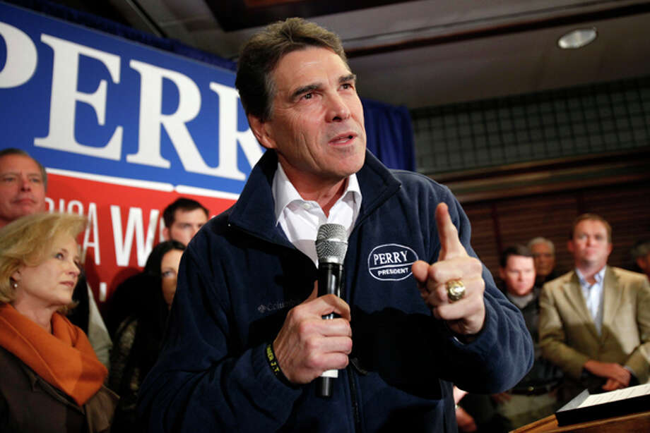 Republican presidential candidate Texas Gov. Rick Perry speaks to local residents during a campaign stop at the Hotel Pattee, Monday, Jan. 2, 2012, in Perry, Iowa. (AP Photo/Charlie Neibergall) Photo: Charlie Neibergall / AP