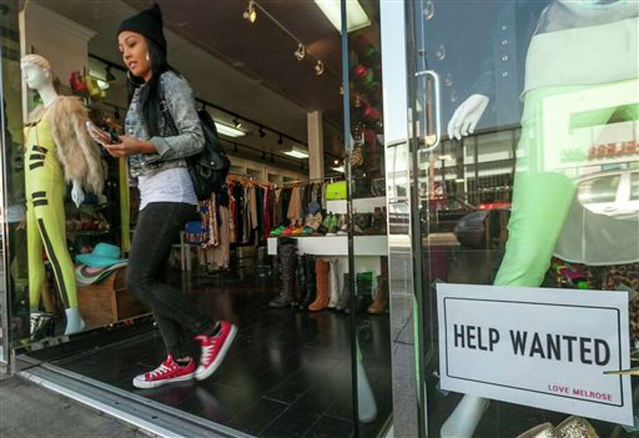 A help wanted sign is posted on the front window of a clothing boutique in Los Angeles Friday, Dec. 7, 2012. The U.S. economy added a solid 146,000 jobs in November and the unemployment rate fell to 7.7 percent, the lowest since December 2008, the Labor Department announced Friday. (AP Photo/Damian Dovarganes) Photo: Damian Dovarganes / Damian Dovarganes2012
