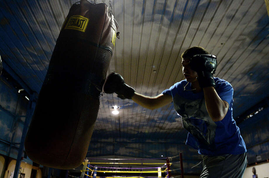 Edgar Rodriguez, 15, works out on the punching bag at Lion Hearted Boxing Gym in Port Arthur. Photo taken Thursday, April 7, 2016 Kim Brent/The Enterprise Photo: Kim Brent / Beaumont Enterprise