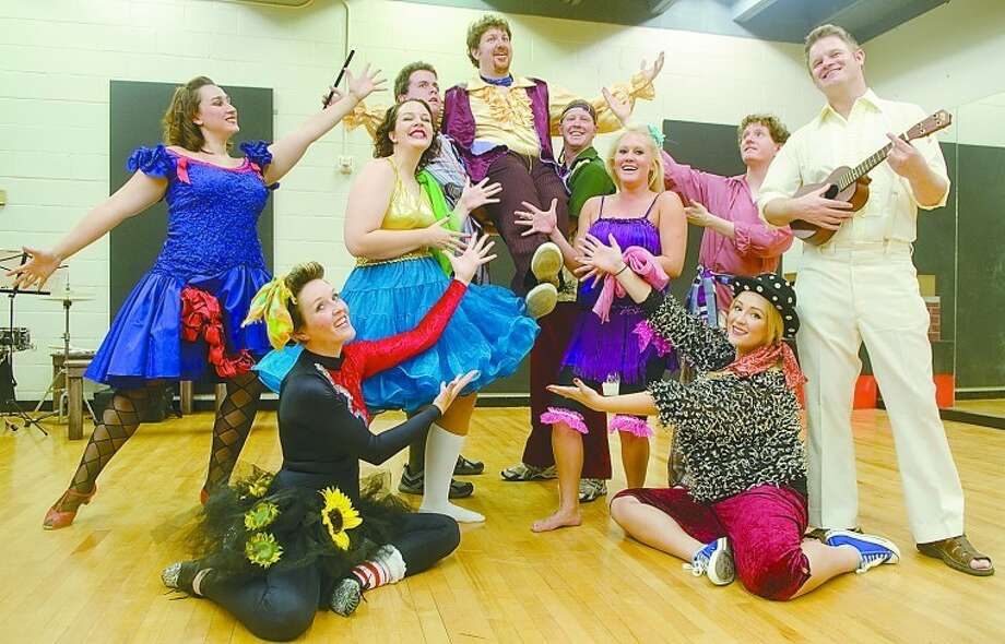 Cast of Godspell, put on by First Presbyterian Church, seated, Jena Tumlin and Jenna Weathers, from left, Emily Bourland, Abby Anderson, Kathryn Celeste, Cole Thomas Carter, Mark Kaufman as Jesus, back, Brian Gravelle and Josh Sparks hold Danny Anderson. Photo by Tim Fischer\ Reporter-Telegram Photo: Tim Fischer