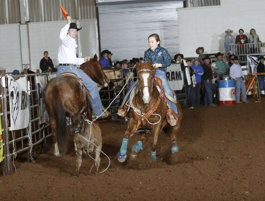 Girls 9 and under champion Jordi Edens competes during last week's Tall City New Year's Calf Roping Blowout at the Horseshoe Arena. The event over New Year's weekend drew around 150 young competitors from various states. Photo courtesy of Chutin Flicks www.chutinflicks.com Photo: Photo Courtesy Chitin Flick