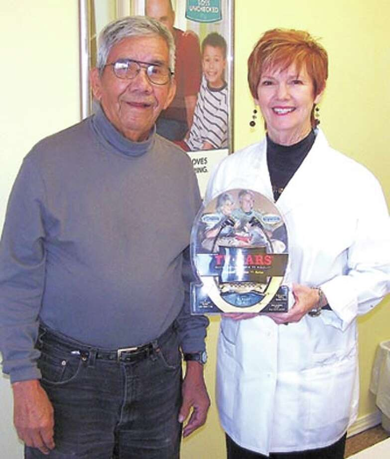 Miracle-Ear held a drawing in December for a TV Ears TV listening system. The winner, Juan Quintana of Midland, is pictured with Miracle-Ear representative Kay Scroggins.