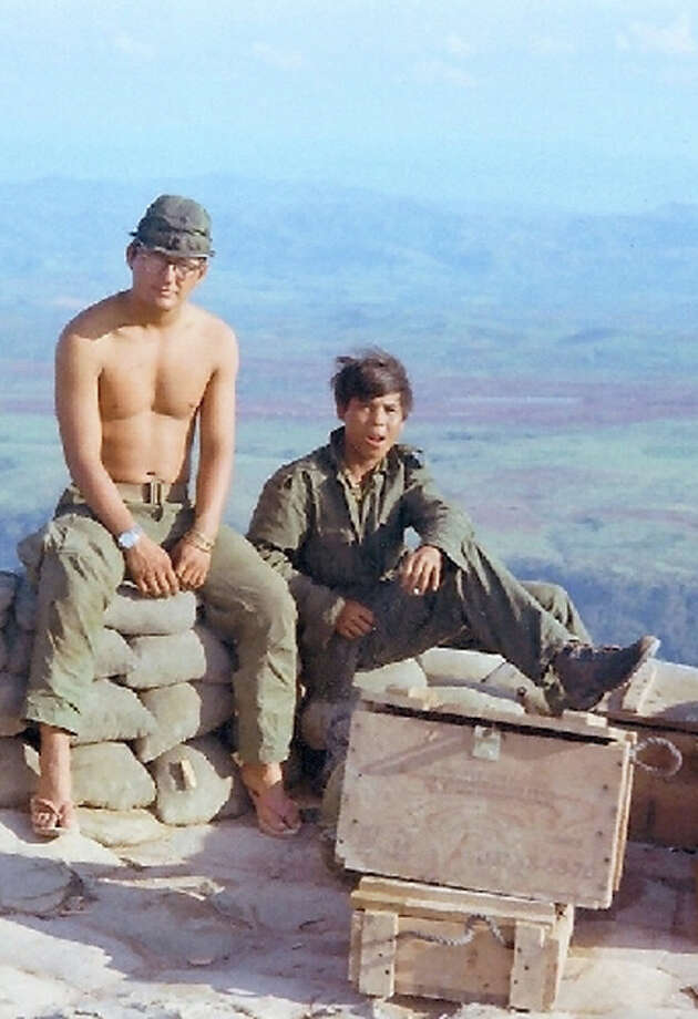 Sgt. John Jones sits with a Montagnard commando during his service in Vietnam. Photo: Courtesy Photo