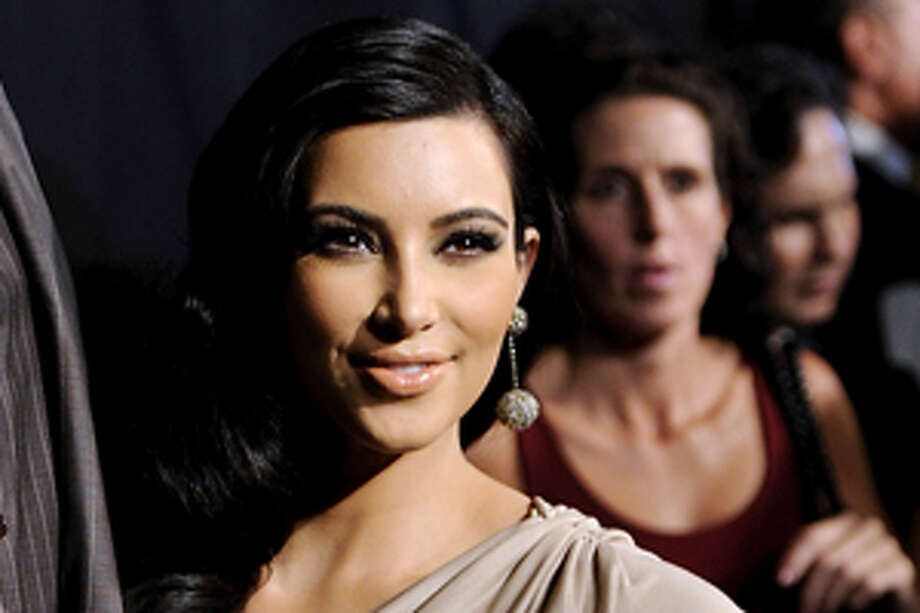 A source tells the new Us Weekly, on stands Friday, that reality star Kim Kardashian and sisters will be immortalized as Barbie's pals in an upcoming limited-edition doll line. Photo: Evan Agostini / AP2011