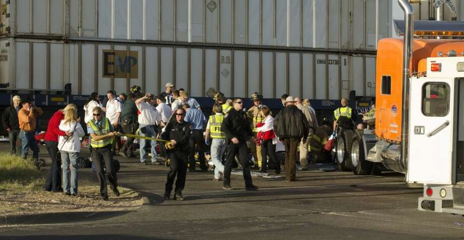 (File Photo) Midland police, fire and sheriffs respond to an accident where a semi trailer carrying veterans in a parade was struck by a train crossing Garfield. Tim Fischer\Reporter-Telegram Photo: Tim Fischer