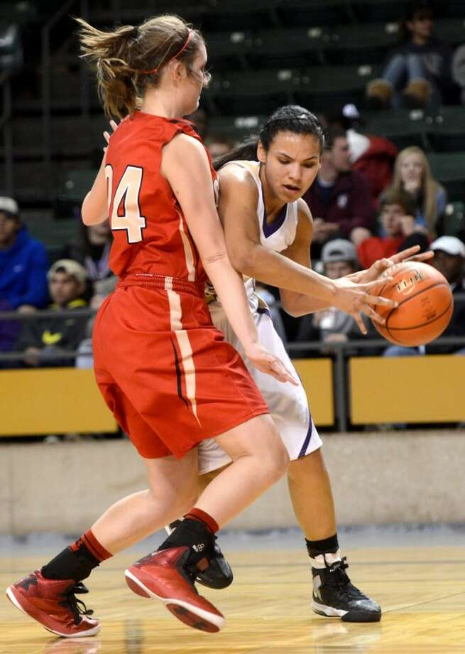 Midland High's Catarina Rendon tries to pass around Lubbock Coronad's Abigail Hopper Tuesday at Chaparral Center. James Durbin/Reporter-Telegram Photo: JAMES DURBIN