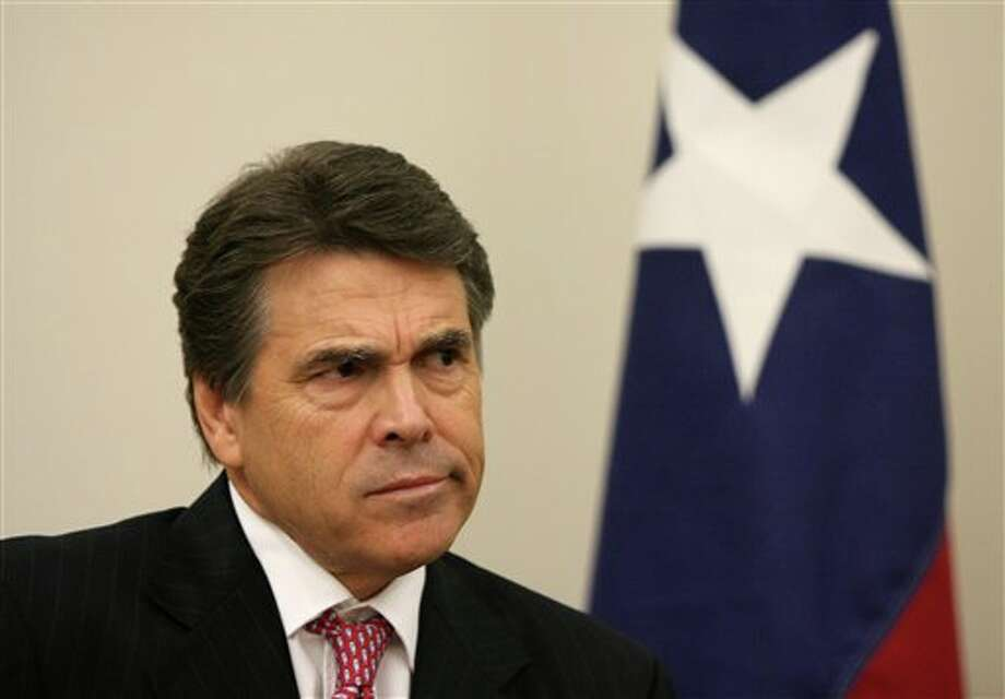 FILE - In this Oct. 13, 2010 file photo, Texas Gov. Rick Perry reacts to questions from news reporters about the Texas Emerging Technology Fund, during a news conference after a town hall meeting with college students at Mountain View College in Dallas. A fourth Texas high-tech startup that received taxpayer money through Gov. Perry's signature economic development fund has filed for bankruptcy, pushing the total losses in the $194 million portfolio beyond what the state says the fund has earned. (AP Photo/The Dallas Morning News, Ben Torres, File) -TV (Mags out, TV out, Internet out, AP Members Only) Photo: Ben Torres / The Dallas Morning News