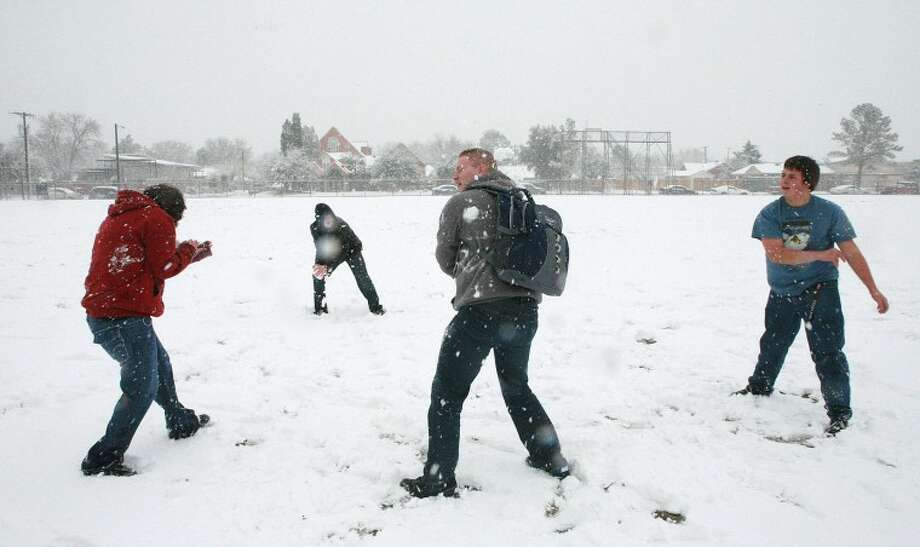 Karra Aguilar, 16, from left, Zach Lyssy, 17, Ryan Hall, 18, and Jay McDaniel, 16, engage in a snowball fight during their lunch break Monday at Midland High School. Cindeka Nealy/Reporter-Telegram Photo: Cindeka Nealy