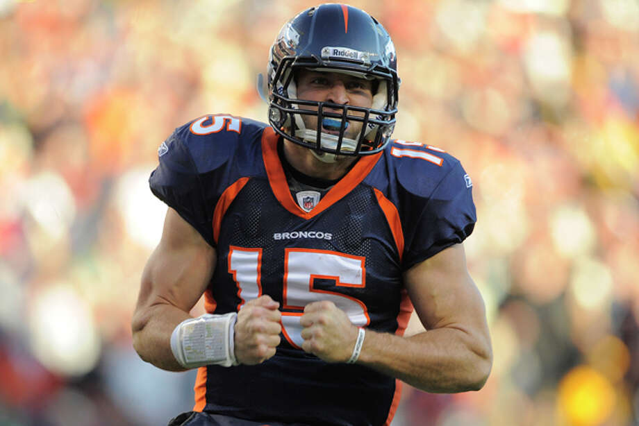 Denver Broncos quarterback Tim Tebow (15) reacts after scoring a touchdown against the Pittsburgh Steelers in the second quarter of an NFL wild card playoff football game Sunday, Jan. 8, 2012, in Denver. (AP Photo/Jack Dempsey) Photo: Jack Dempsey / FR42408 AP