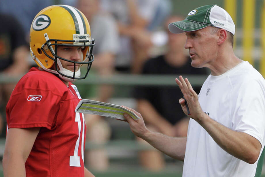 FILE - In this Aug. 2, 2010, file photo, Green Bay Packers' Matt Flynn talks to offensive coordinator Joe Philbin during NFL football training camp, in Green Bay, Wis. Divers have recovered the body of the Philbin's son from an icy Wisconsin River, but police said Tuesday, Jan. 10, 2012 they do not suspect foul play. Michael Philbin, 21, disappeared at about 2 a.m. Sunday after an outing with friends in the University of Wisconsin-Oshkosh campus area, about 50 miles from Green Bay. (AP Photo/Morry Gash, File) Photo: Morry Gash / AP2010