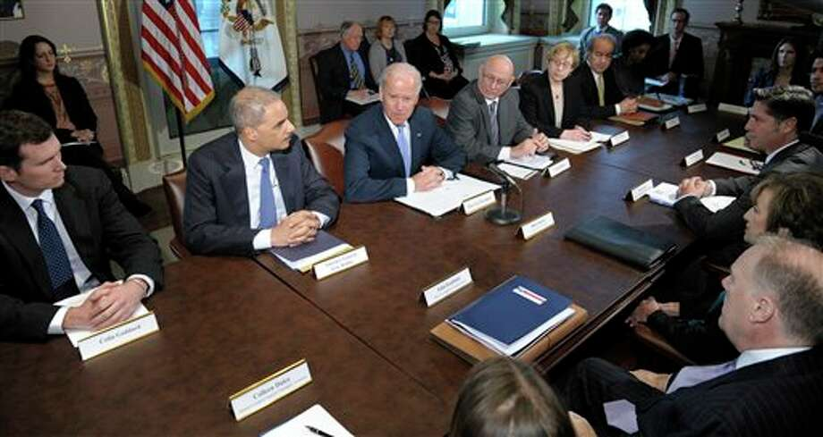 Vice President Joe Biden, center, with Attorney General Eric Holder at left, speaks during a meeting with victims' groups and gun safety organizations in the Eisenhower Executive Office Building on the White House complex in Washington, Wednesday, Jan. 9, 2013. Biden is holding a series of meetings this week as part of the effort he is leading to develop policy proposals in response to the Newtown, Conn., school shooting (AP Photo/Susan Walsh) Photo: Susan Walsh / AP