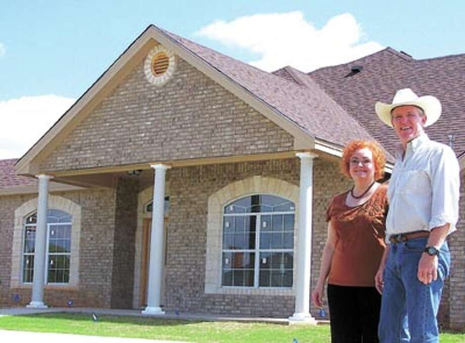 """Builder Mike Davis has done many closings with Permian Abstract's Jan Oberle over the years. """"She gets things done,"""" he says."""