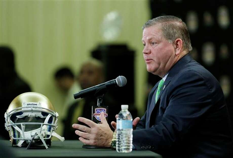 Notre Dame head coach Brian Kelly speaks during a news conference for the BCS National Championship college football game Sunday, Jan. 6, 2013, in Miami. (AP Photo/Chris O'Meara) Photo: Chris O'Meara / AP