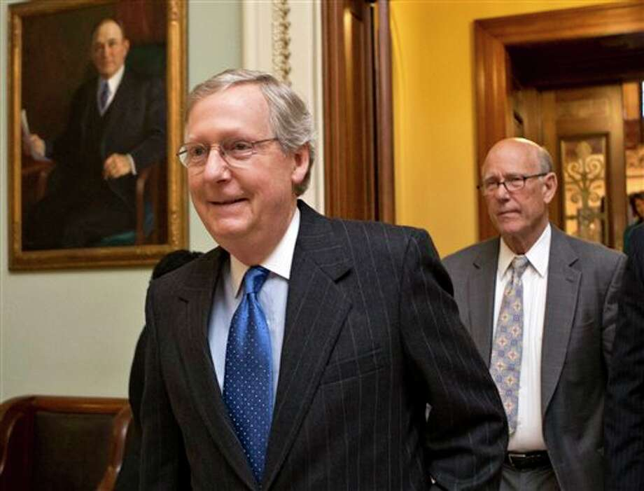 """FILE - This Dec. 30, 2012 file photo shows Senate Minority Leader Mitch McConnell of Ky., followed by Sen. Pat Roberts, R-Kansas leaving the Senate chamber on Capitol Hill in Washington. President Barack Obama says he won't let Republicans threaten a debt ceiling crisis to extract deeper federal spending cuts, but congressional Republicans say he has no choice. The tough talk suggests this year's political fight could be even nastier and more nerve-grating than the """"fiscal cliff"""" showdown. (AP Photo/J. Scott Applewhite, File) Photo: J. Scott Applewhite / AP"""