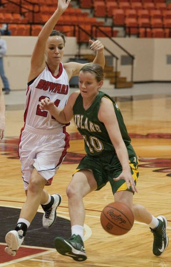 Midland College's Meghan Braeuer brings the ball down court as Howard College's Marion Lemonnier defends last week in Big Spring. Tim Fischer\Reporter-Telegram Photo: Tim Fischer