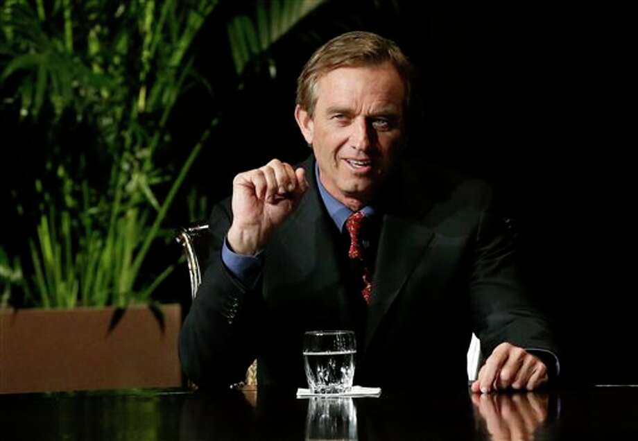 Robert F. Kennedy Jr., left, makes comments during the opening minutes of a interview with journalist Charlie Rose in front of a full audience at the AT&T Performing Arts Center Friday, Jan. 11, 2013, in Dallas, Texas. The Kennedys are in Dallas as a year of observances begins for the 50th anniversary of President John F. Kennedy's assassination. (AP Photo/Tony Gutierrez) Photo: Tony Gutierrez / AP