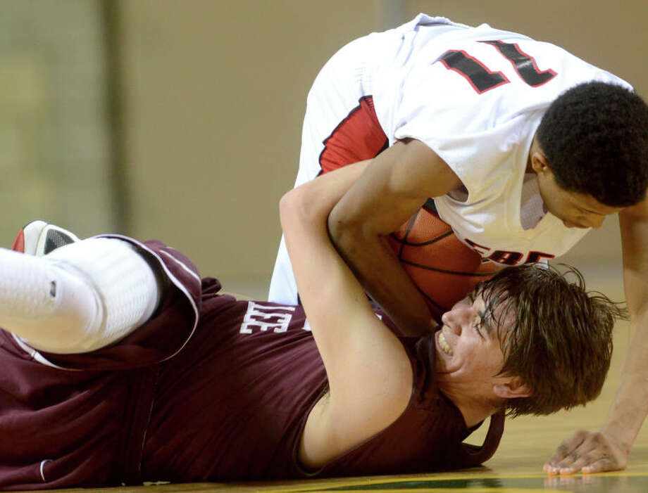 Midland Lee's Jordan Williams fights to keep possession of the ball against Amarillo Tascosa's Ja'Quan Smith Friday at Chaparral Center. Amarillo Tascosa beat Midland Lee 55-42. James Durbin/Reporter-Telegram Photo: JAMES DURBIN / © 2012 Midland Reporter Telegram. All Rights Reserved.