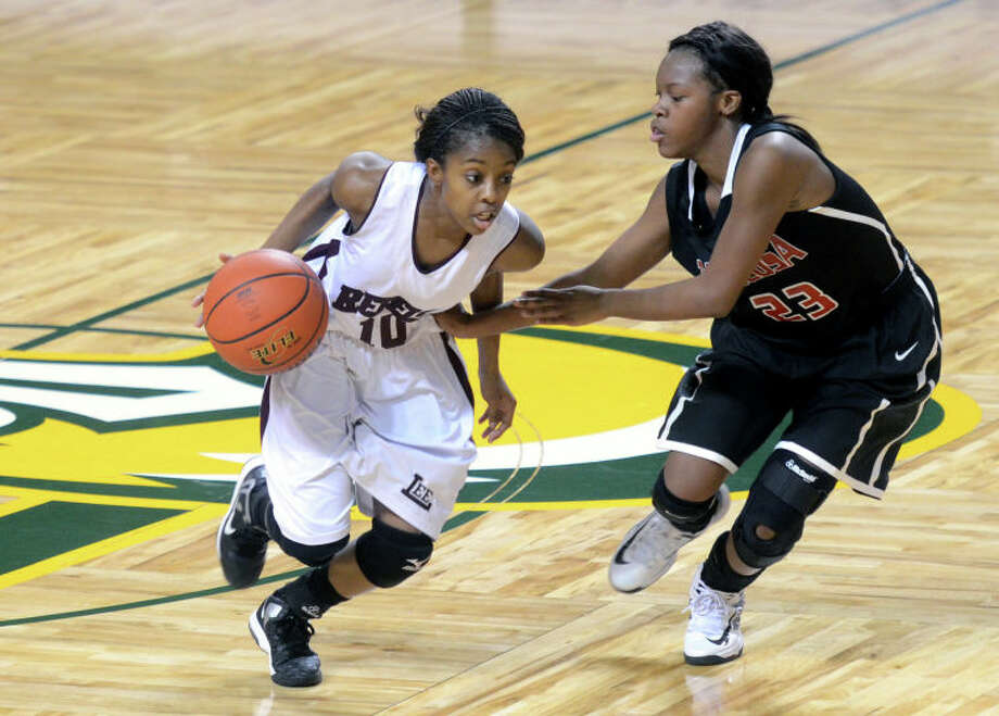 Midland Lee's Daija Stanford runs around Amarillo Tascosa's LaTravia Taylor Friday at Chaparral Center. Midland Lee beat Amarillo Tascosa 65-64. James Durbin/Reporter-Telegram Photo: JAMES DURBIN / © 2012 Midland Reporter Telegram. All Rights Reserved.