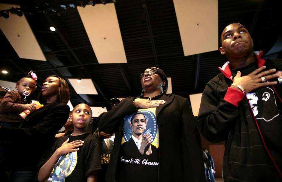 (left to right) Taneekwa Ross holds her neice Brooklyn Woodard as she sings the national anthem along with her cousin Jaquaylon Merritt, mother Wanda Ross and Bryan Phelps at a celebratory rally held in honor of then President-elect Barack Obama's victory in this 2008 file photo. The event, for which the elder Ross was a co-chair, was held at the Martin Luther King Community Center Saturday afternoon. Photo by Photo: Midland
