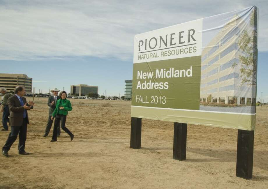 Scott Sheffield, Clayton Williams and Modesta Williams look at the newly unvieled sign Monday after the announcement of a new office building to be built in Clay Desta Plaza. Photo by Tim Fischer/Midland Reporter-Telegram Photo: Tim Fischer